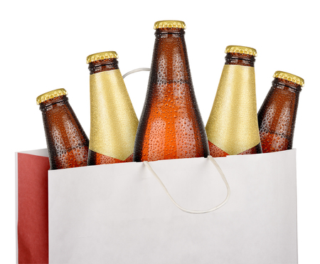 dewed: Bag with brown beer bottles isolated on white background Stock Photo