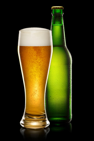 dewed: Green wet Bottle of beer and glass of beer on black background.