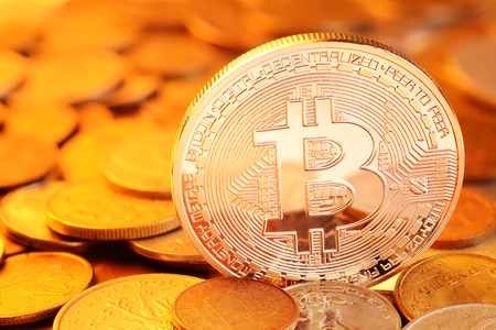 decentralized: Golden Bitcoin on different coins heap. Electronic money exchange concept
