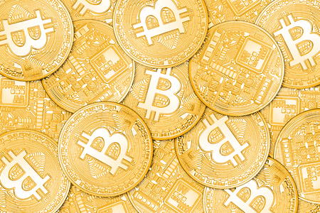 decentralized: Heap of one golden bitcoins coins. Can be use as background