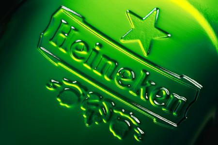 Brest, Belarus - October 15 2016:  Logo of the brand Heineken on the green beer bottle. Macro shot 版權商用圖片 - 64681254