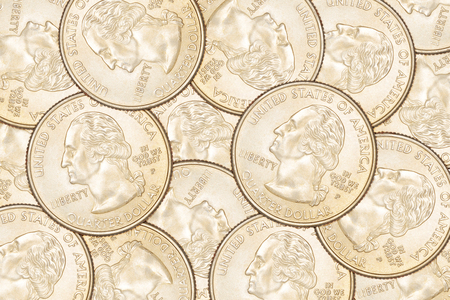 25 cents: Heap of ten US 25 cent quarter coins. Can be use as background