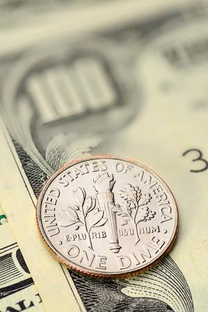 us coin: Dime US cent coin on hund dollar bill. Macro shot Stock Photo