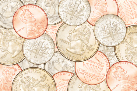 25 cents: Heap of different US coins. Can be use as background
