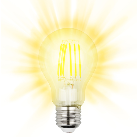 Glowing yellow light LED filament bulb on a white background Stock Photo