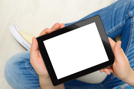 blank tablet: Men holding black touch screen tablet computer with blank screen