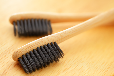 Wooden eco bamboo toothbrushes with black bristle macro shot