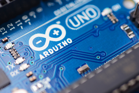Brest, Belarus - August 22, 2017: Arduino UNO PCB board microcontroller for programming education development. Logo macro shot Editorial