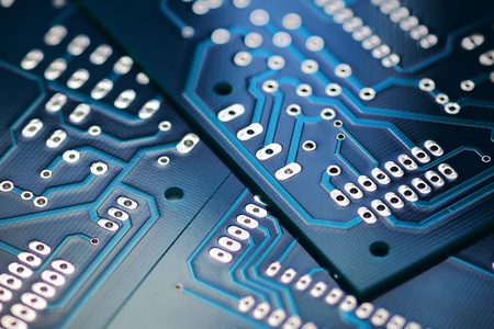 Through the hole technology blue  printed circuit board. Macro shot