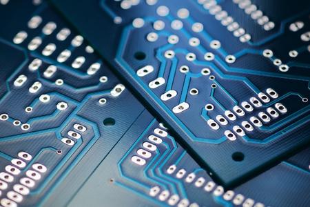 Through the hole technology blue  printed circuit board. Macro shot
