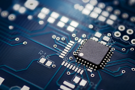 Electronic chip component on the blue printed circuit board 스톡 콘텐츠