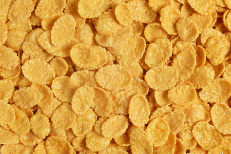 Corn flakes background or backdrop close up macro shot Imagens
