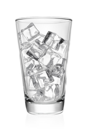 Empty transparent glass with ice cube rocks isolated on white background. Stock Photo