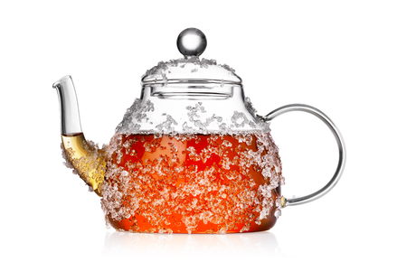 Transparent glass teapot with crushed ice isolated on white background. Ice tea concept