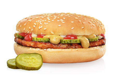 Classic hamburger with beef patty, pickles, tomato, onion, ketchup and mustard isolated on white background.