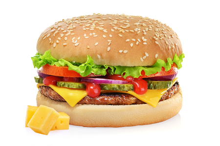 Classic cheeseburger with beef patty, pickles, cheese, tomato, onion, lettuce and ketchup mustard isolated on white background. Imagens