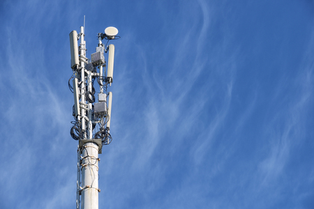 Telecom cellular base station towers at blue sky with copy space for text
