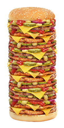 Very tall cheeseburger with beef patty, pickles, cheese, tomato ketchup, onion and mustard isolated on white background.