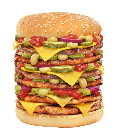 Very big cheeseburger with beef patty, pickles, cheese, tomato ketchup, onion and mustard isolated on white background.
