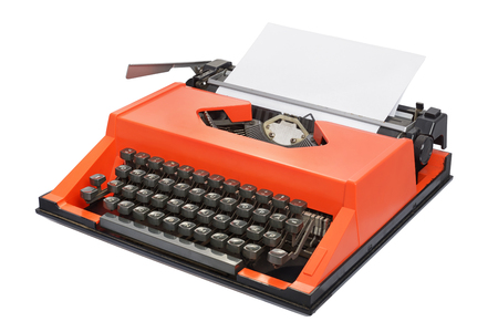 Red typewriter with Danish keyboard layout isolated on white background. Side view Stockfoto