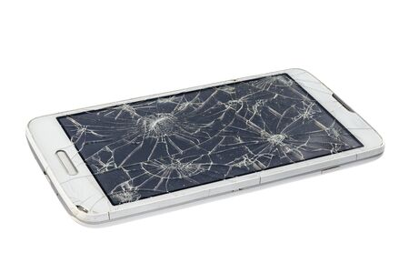 Broken shattered damaged smartphone isolated on white background Foto de archivo
