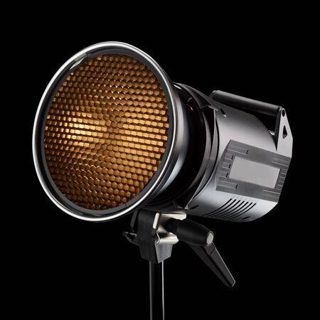 Professional photography studio flash light with honeycomb on black background