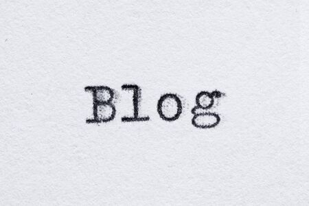 Blog word on white paper printed with old fashion typewriter font