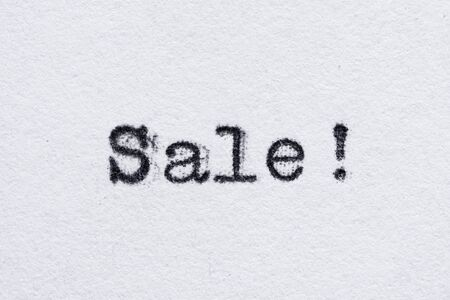 Sale word on white paper printed with old fashion typewriter font 스톡 콘텐츠
