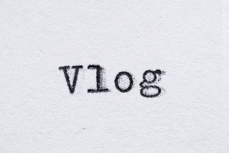 Vlog word on white paper printed with old fashion typewriter font 스톡 콘텐츠