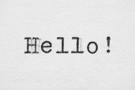 Hello word on white paper printed with old fashion typewriter font 스톡 콘텐츠