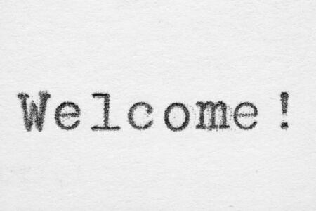 Welcome word on white paper printed with old fashion typewriter font