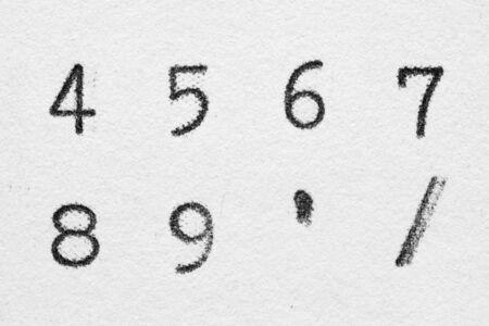 Real typewriter font alphabet with digits 4, 5, 6, 7, 8, 9 symbols Slash, Quotation mark on white paper. Macro shot