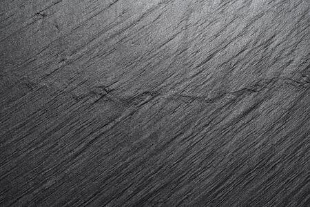 Dark black slate background or texture.