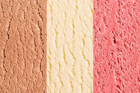 Neapolitan ice cream texture or background with vanilla, chocolate and strawberry flavor.