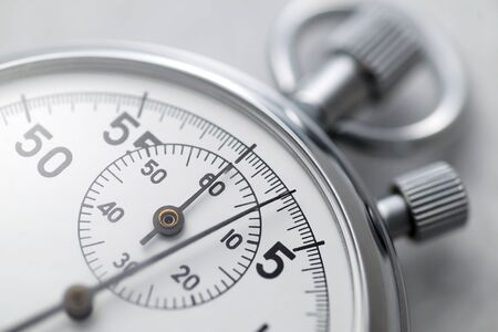 Classic metallic chrome mechanical analog stopwatch. Close up shot. 免版税图像