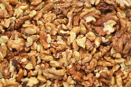 Heap of peeled walnut kernels. Can be used as background or backdrop 版權商用圖片