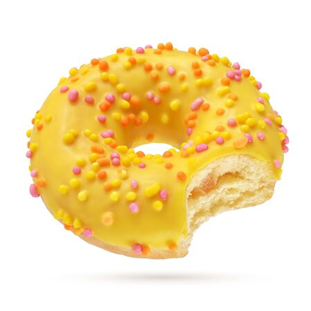 Yellow glazed bitten round donut isolated on white background. Side view