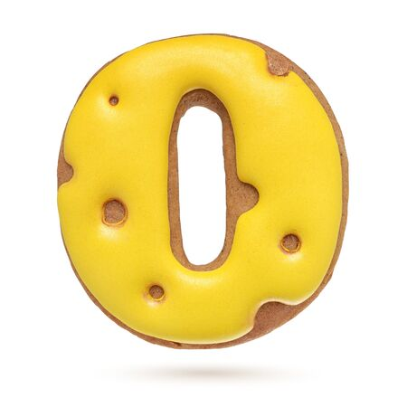 Capital letter O yellow homemade gingerbread biscuit isolated on white background. Banco de Imagens