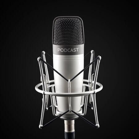 Silver studio condenser microphone with podcast word on black background Standard-Bild