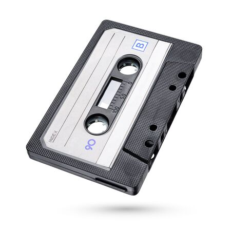 Old black audio tape compact cassette isolated on white background with clipping path