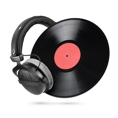 Professional headphones and 12-inch LP vinyl record isolated on white background