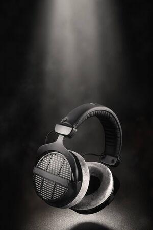 Studio headphones. Professional over-ear open back earphones on black background.