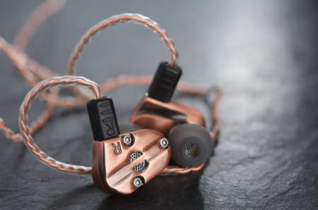 Hybrid dynamic driver balanced armature earbuds. Copper metallic color.