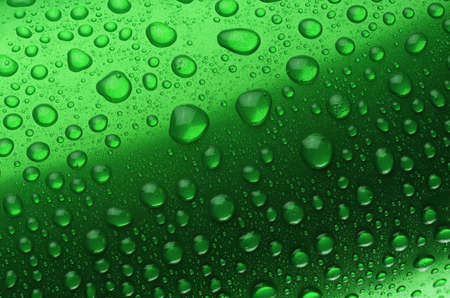 Green aluminum can with water drops or dew close-up macro shot.