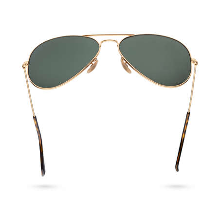 Classic aviator sunglasses with golden frame isolated on white background