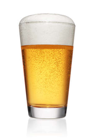 Full glass of light yellow beer isolated on white background. Foto de archivo