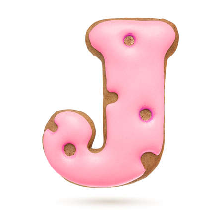 Capital letter J. Pink gingerbread biscuit isolated on white background. Christmas decoration Banque d'images