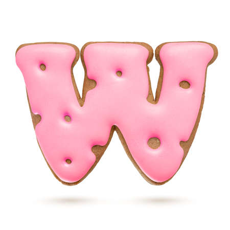 Capital letter W. Pink gingerbread biscuit isolated on white background. Christmas decoration
