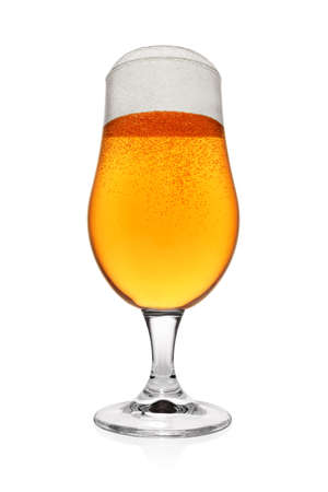 Full glass of light yellow beer isolated on white background. Wide angle shot.