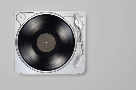 Turntable with long play or LP vinyl record on gray background. Copy space